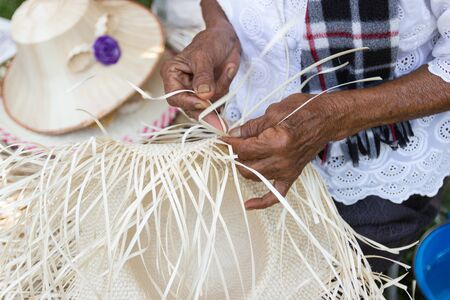 The villagers took bamboo stripes to weave into different forms for daily use utensils of the community's people in Bangkok Thailand, Thai handmade product.