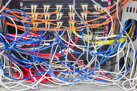 Bangkok Thailand - June 25, 2019 : cable network in server room cable tangled of poorly routed cables Concept Organized Cabling in server rooms