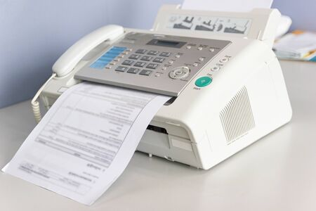 The fax machine for Sending documents in the office concept equipment needed in office