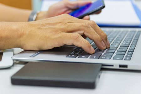 business man typing on laptop keyboard in work office concept business life work office