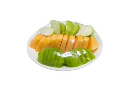 fruits which are wrapped with plastic film preservation on a table isolated white background