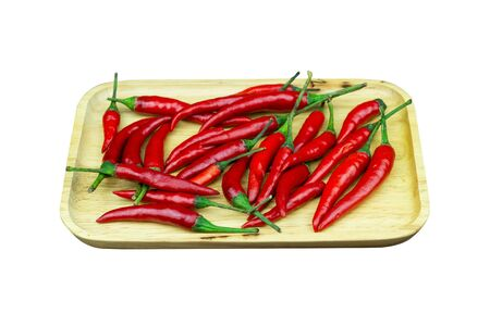 Chili - The pepper plants to the nature of the sphere of the long spikes on wood isolated white background