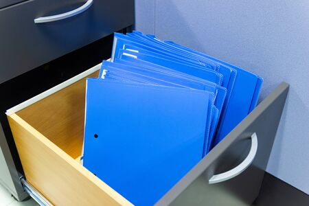 blue file folder documents In a file cabinet retention of contracts.