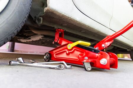 red tool jack lift car for Maintenance and service of cars at Car care maintenance Stok Fotoğraf