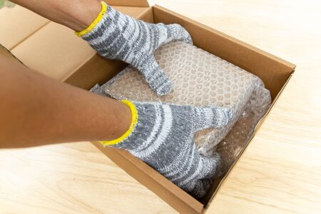 hand of man hold plastic wrap, for protection parcel product cracked or insurance During transit Stok Fotoğraf