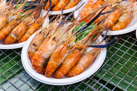 Grilled shrimps of seafood Street food of Thailand on the table in market of Bangkok Thailand Stok Fotoğraf
