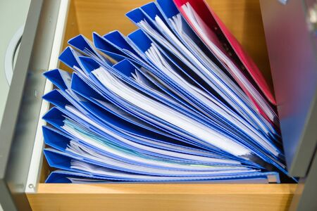 blue file folder documents In a file cabinet retention of contracts. Banque d'images