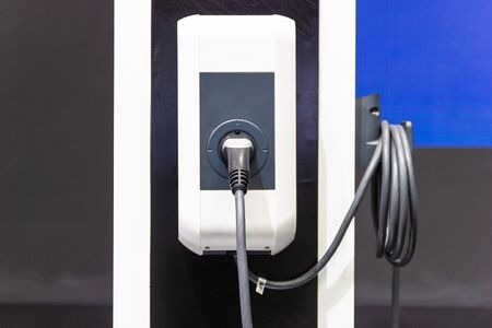 the charging the battery for the car new Automotive Innovations the power supply plugged into an electric car being charged, concept of energy innovation.