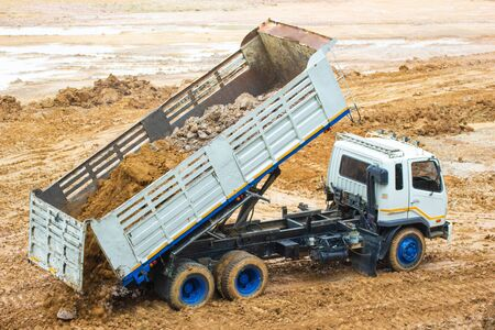 Big dump truck working Delivery of sand to the construction site and raised body in the construction industry