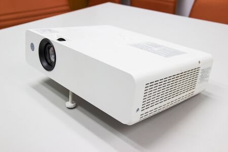 white projector for presentation for business work on table in a meeting room Archivio Fotografico - 130128504