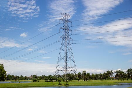 High voltage transmission towers for supplying electricity in the city with blue sky Bangkok Thailand