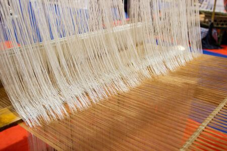Weaving equipment Household weaving - Detail of weaving loom for homemade silk Used for silk weaving or textile production of Thailand