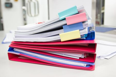 file folder and Stack of business report paper file on the table in a work office, concept document in work office Reklamní fotografie