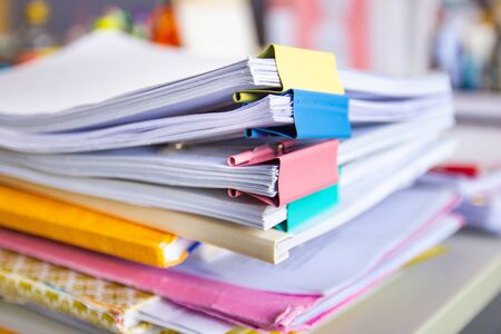 file folder and Stack of business report paper file on the table in a work office, concept document in work office Stok Fotoğraf