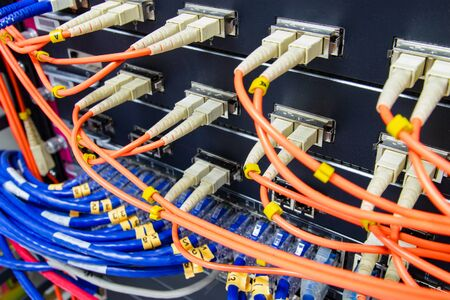 cable network , fiber optic cable connect to switch port in server room , Concept network management