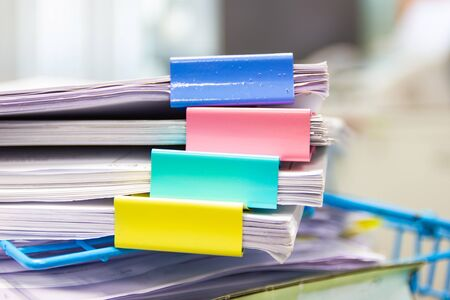 file folder and Stack of business report paper file on the table in a work office, concept document in work office Фото со стока