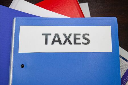 Folder Tax documents and paper files concept Annual tax payment