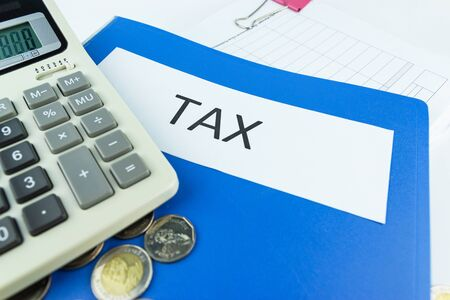 Folder Tax documents and paper files with calculator concept Annual tax payment