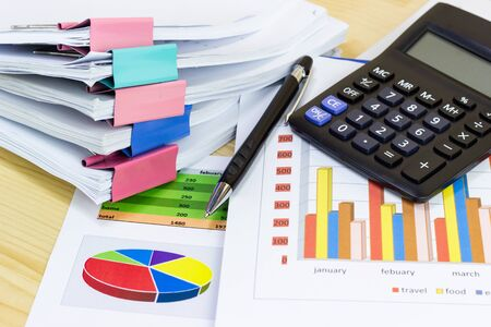 business paper graphs calculator pencil with charts report, concept financial planning, concepts business and cost. Stock Photo