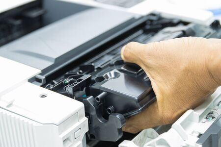 Technicians replacing toner in laser printer concept office supplies repair