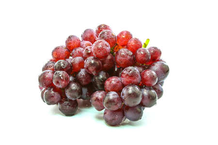 fresh grapes on Wooden tray with isolated white background