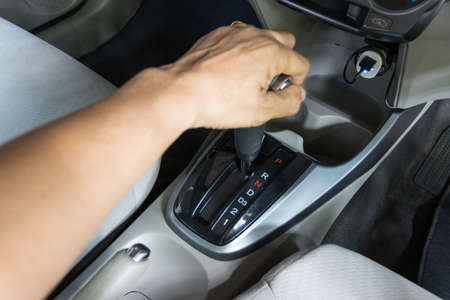 hand of man hold Gear R  Reverse the gear selected to drive the vehicle backward
