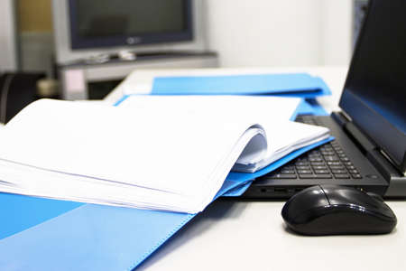 Blue Document folder with Notebook on table at office
