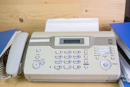 The fax machine for Sending documents in the office concept equipment needed in office Standard-Bild