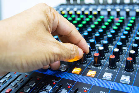 hands of Men are controlling the console of a large hi-fi system. Sound equipment. Control panel of a digital studio