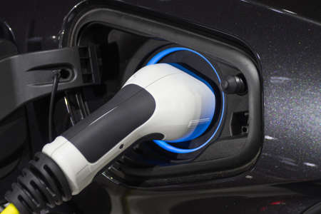 the charging the battery for the car new Automotive Innovations the power supply plugged into an electric car being charged