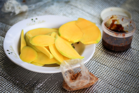 Yellow slice of  mango and sweet sauce ,tropical fruits