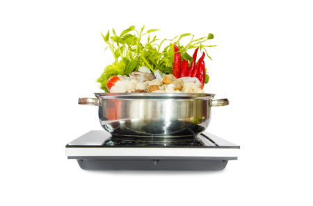 Home appliance electric aluminum sukiyaki cooking pot in the kitchen interior Zdjęcie Seryjne