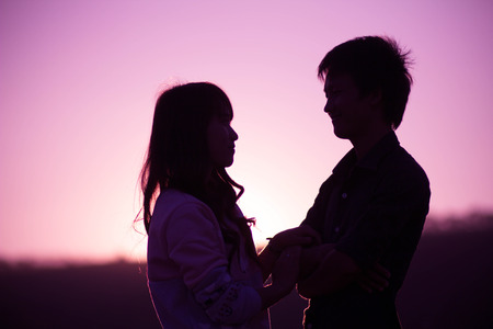 Young couple asian in love  outdoor purple