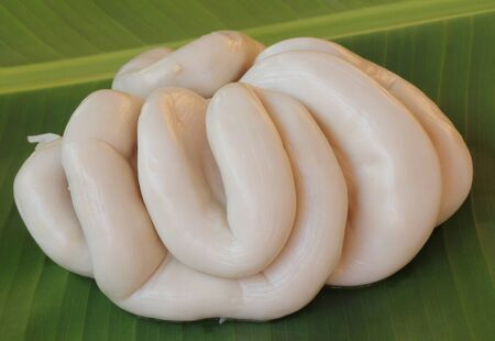 chitterlings: chitterlings in banana leaves on the ground Stock Photo