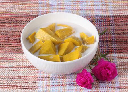 coconut milk: Thai Dessert, Pumpkin in Sweet Coconut Milk on white background