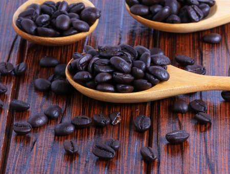 finished good: Coffee beans on the wooden floor Stock Photo
