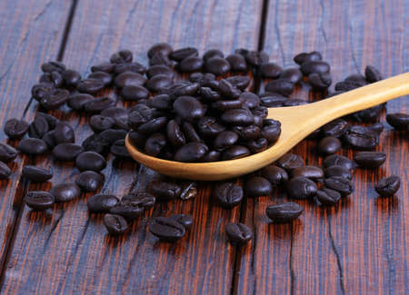 antecedents: Coffee beans on the wooden floor Stock Photo
