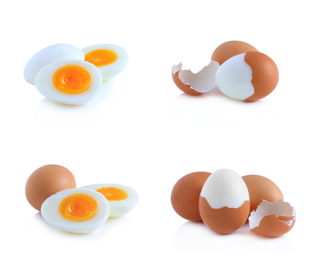 a faction: Boiled eggs cut in half isolated on white background. Stock Photo