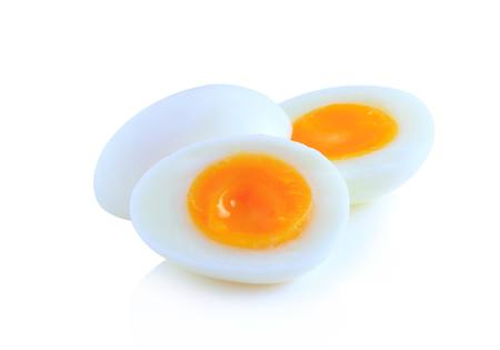 breakfast eggs: Boiled eggs cut in half isolated on white background. Stock Photo