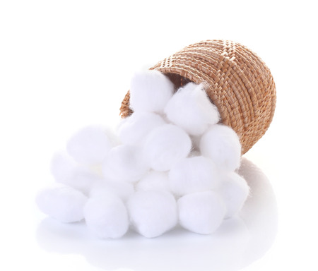 cotton wool in  basket on white background