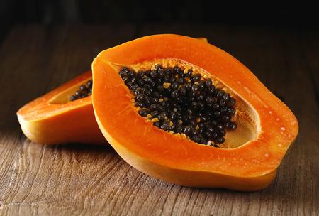 sliced papaya on wooden