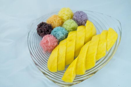 Thai dessert sweet mango with colorful sticky rice photo