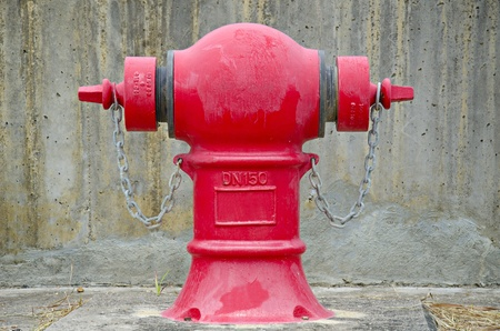 Red fire hydrant over the wall photo