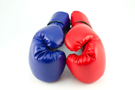 A pair of blue boxing gloves on white background