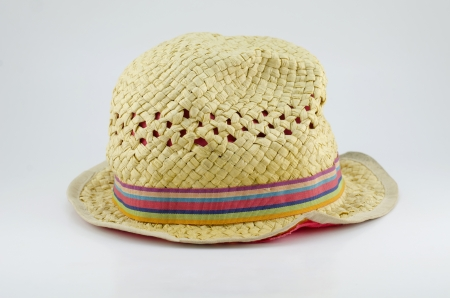 jaunty: Sombrero de paja de la vendimia en el fondo blanco Foto de archivo