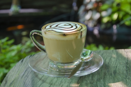 coffe tree: coffe on wooden table in garden  Stock Photo