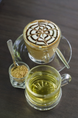 coffee hour: Make coffee latte with cream on black table