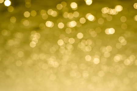 Christmas flavored golden glittery background.
