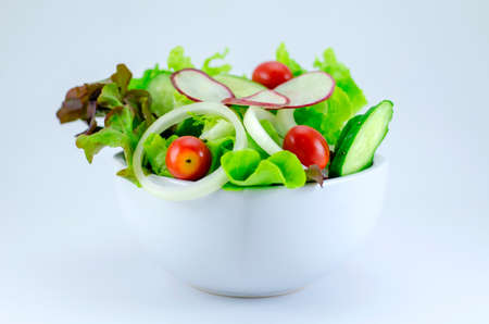 healthy salad in plate over white photo