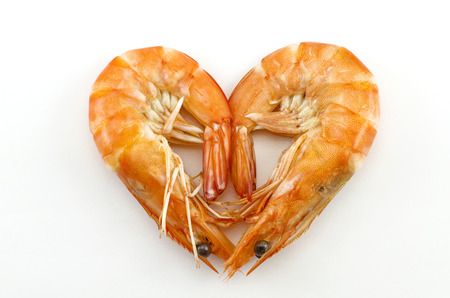 Boiled shrimp isolated on white with heart shape photo